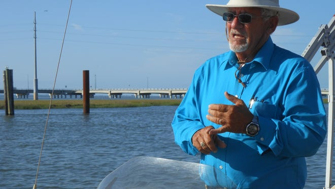 Ray Davis narrates a boat trip around Chincoteague Island for Captain Dan's Tours. His son, Dan, owns the business.