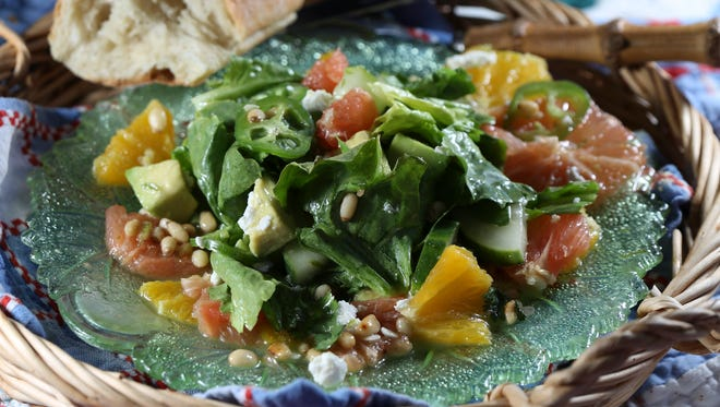 The citrus and avocado escarole salad served at PICNIC. June 13, 2016