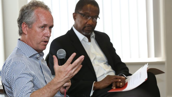 """Mayor Greg Fischer, left, addressed a group assembled at the Yearlings Club in the West End for a """"fireside chat"""" as moderator Nat Irvin, II, a professor in the University of Louisville School of Business, looks on.Sept. 18, 2016"""