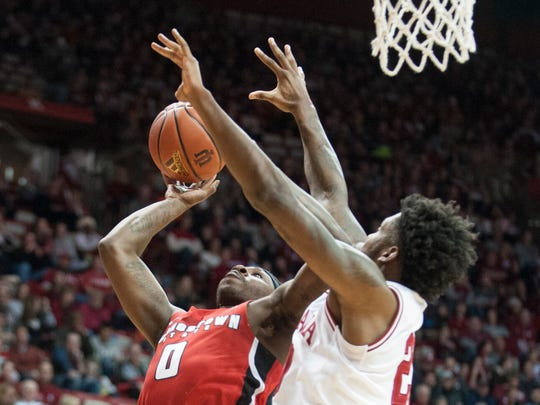 Indiana forward De'Ron Davis (20) tries to defend Youngstown State forward Tyree Robinson (0) during the first half of an NCAA college basketball game in Bloomington, Ind., Friday, Dec. 29, 2017.