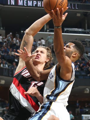 Memphis Grizzlies Andrew Harrison, right, is defended by Portland Trail Blazers Meyers Leonard, left,  at FedExForum.