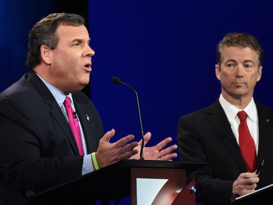 Republican Presidential hopeful Chris Christie (L) speaks as Rand Paul looks on during in the CNBC Republican Presidential Debate, October 28, 2015 at the Coors Event Center at the University of Colorado in Boulder, Colorado.