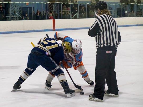 Rochester Monarchs' Hayden Nichol (21) and Detroit