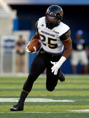 Southern Miss running back Ito Smith runs the ball against Kentucky on Saturday during their game in Lexington, Kentucky.