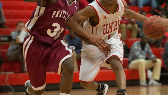 Robert E. Lee guard Kendarius Hartwell drives against Prattville's Carlos Coleman during the Class 7A, Area 3 tournament game on Thursday at Robert E. Lee.
