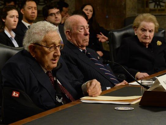 Former Secretaries of State Henry Kissinger, left,