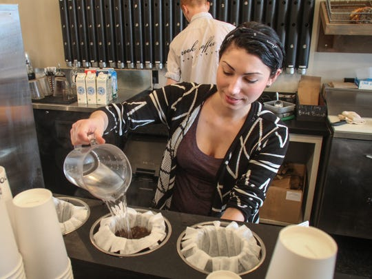 At Rook Coffee Roasters in Ocean Township,  barista Nicole Calascibetta pours a coffee in this 2014 photo.