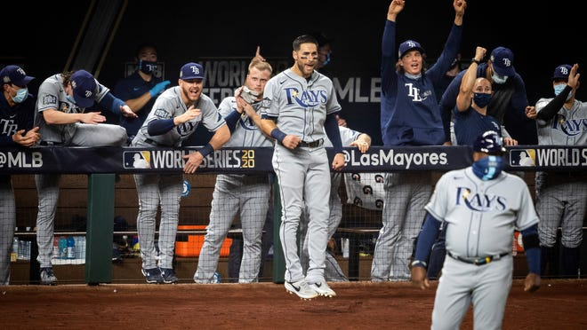 The Rays celebrate after a home run against the Dodgers Wednesday night during Game 2 of the World Series.