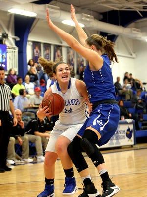 Highlands guard Zoie Barth gets fouled by Mason County's Kara Moran as she drives to the basket.