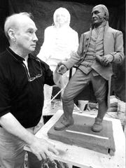 Sculptor Frank Gaylord examines his half-scale model for a sculpture of Thomas Chittenden, Vermont's first governor, at his studio in Barre, Vt., Tuesday, July 29, 1997. The full size sculpture is at rear.