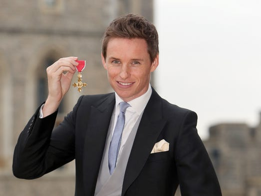 Eddie Redmayne poses after he was made an OBE (Officer