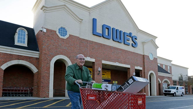 An unidentified customer leaves a Lowe's home improvement store in Charlotte, N.C., on Tuesday, Nov. 18, 2014. A former employee at a Lowe's in Orangeburg, N.Y., alleges in a federal lawsuit that he was discriminated against for years at the store because he's gay.