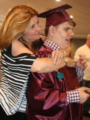 Deb Edwards hugs her nephew, Chris Hable, after the