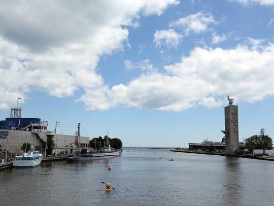 Kayak paddlers pass the Skyline Princess tour boat,