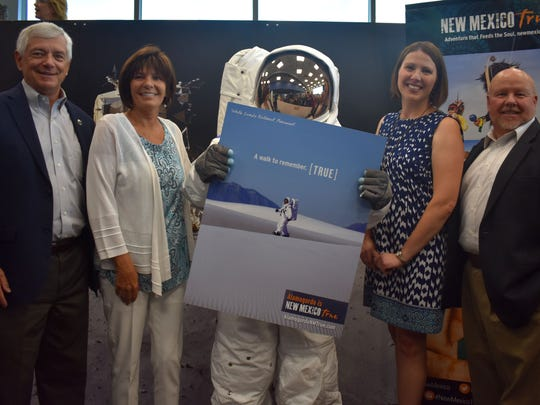 Sen. Ron Griggs, Rep. Yvette Herrell, Cabinet Secretary Rebecca Latham and Sen. Bill Burt stand with the New Mexico Museum of Space History's astronaut.