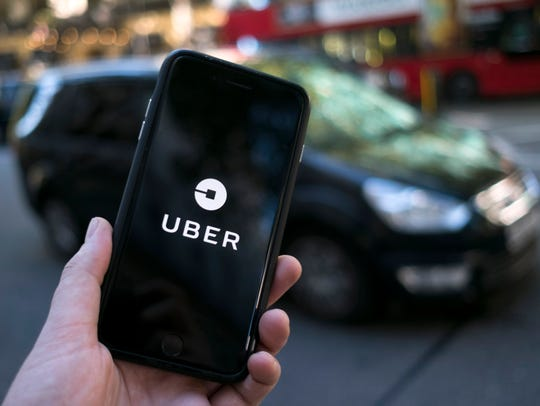 File photo taken in 2017 shows ride-hailing app Uber's