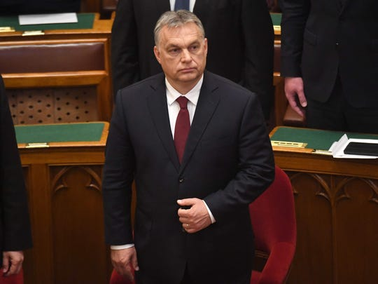 Hungarian Prime Minister Viktor Orban looks on during
