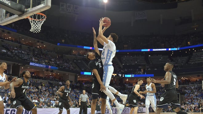 North Carolina Tar Heels forward Justin Jackson (44) shoots over Butler Bulldogs guard Kethan Savage (11) in the first half during the semifinals of the South Regional of the 2017 NCAA Tournament at FedExForum.