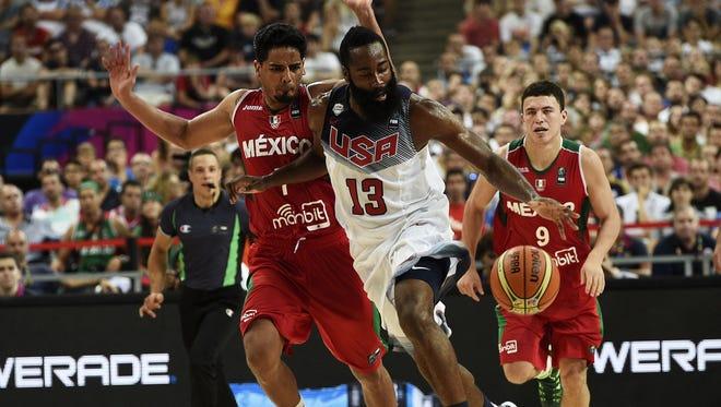 US forward James Harden dribbles past Mexico's guard Jorge Gutierrez (L) in Team USA's win Saturday.
