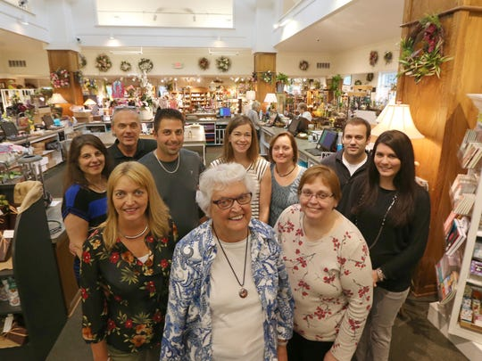 Hilda Horeth, front center, matriarch of the Horeth family, is surrounded the generations of her family who all work at their Kittelberger Florist & Gifts in Webster.