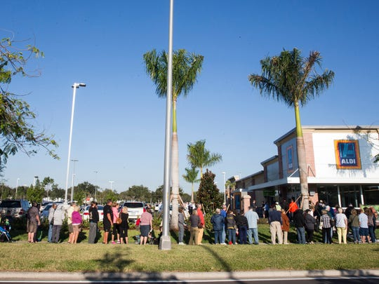 People wait in line for the grand opening of the area's first Aldi grocery store Nov. 17, 2016, in North Naples.
