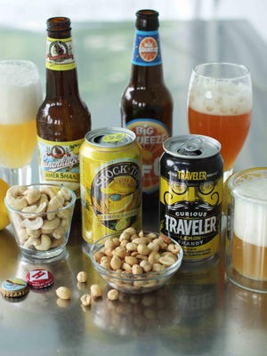 This June 15, 2015 photo shows MillerCoors' Leinenkugel's Summer Shandy, Shock Top Lemon Shandy from Anheuser-Busch, Harpoon Brewery's UFO Big Squeeze Shandy and Curious Traveler Lemon Shandy from The Traveler Beer Co. in Concord, N.H. The shandy, classically beer mixed with lemonade, though other flavors can be used, has been a seasonal staple in Europe since at least the mid-1800s. (AP Photo/Matthew Mead)