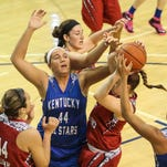Kentucky's Liza Tibbs, from Dixie Heights High, defends Ohio's Kym Royster during the All Star game at TMC Saturday,