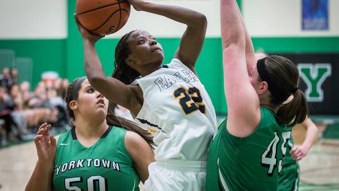 Delta's Micaya Richardson shoots past Yorktown's defense during their game at Yorktown High School Wednesday, Jan. 13, 2016.
