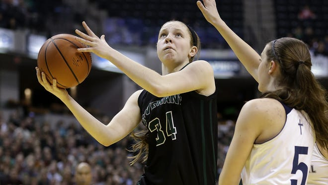 Covenant Christian Warriors Rachel McLimore (34) drives around Lafayette Central Catholic Knights Lexi Thompson (5) in the first half of their 2A IHSAA Girls Basketball State Finals Saturday, Feb 27, 2016, afternoon at Bankers Life Fieldhouse.