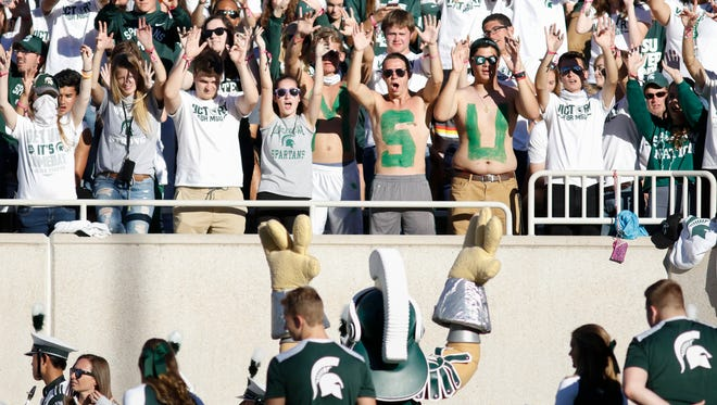 MSU football fans cheer on the Spartans against Iowa Saturday, Sept. 30, 2017, at Spartan Stadium in East Lansing.