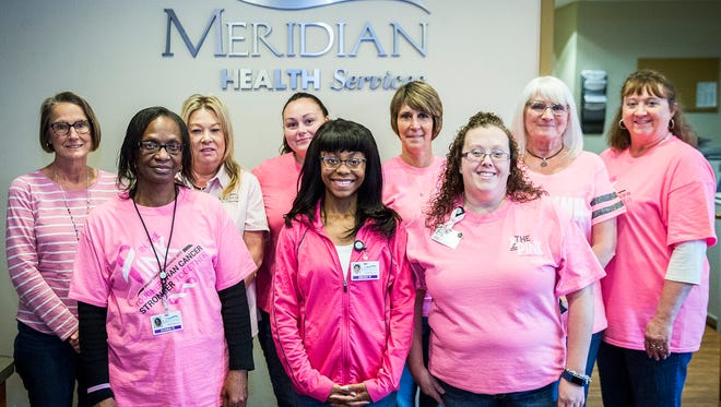 The Meridian Health Services staff show off their pink shirts for breast cancer awareness on In the Pink Day 2017.
