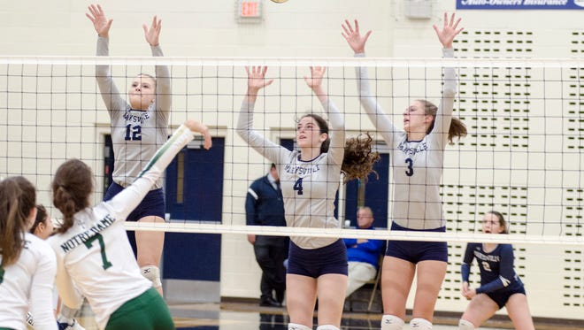 Marysville's Hayley Delor (12), Paige Fraley (4) and Heather Bowns (3) jump to block a hit by Pontiac Notre Dame's Natalie Risi during the MHSAA Class B Regional Semifinal volleyball game at North Branch High School Nov. 7.