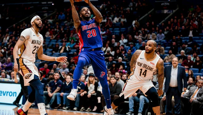 Pistons guard Dwight Buycks (20) shoots over Pelicans forward Anthony Davis (23) and guard Jameer Nelson (14) during the first quarter on Monday, Jan. 8, 2018, in New Orleans.