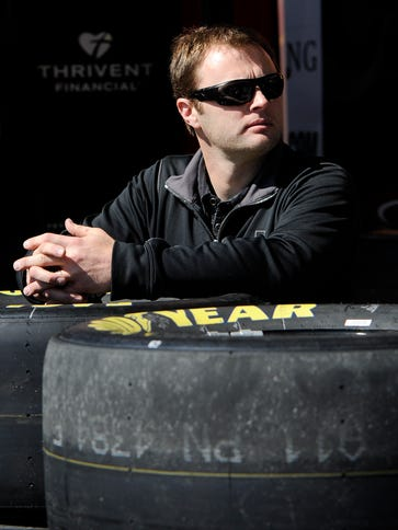 NASCAR driver Travis Kvapil waits in the the garage