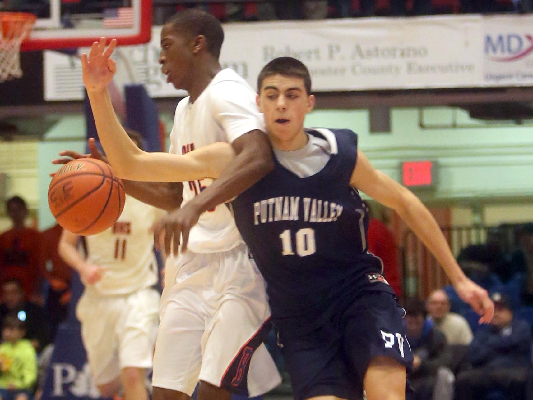 Putnam Valley's Harrison Deegan tries to steal the ball from Briarcliff's Josiah Cobbs during the the Section 1 Class B basketball championship at the Westchester County Center in White Plains Feb. 27, 2016. Briarcliff defeated Putnam Valley 53-42.