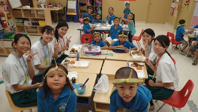 Students from Midori Seiho High School Osaka, Japan, visit the Guahan Academy Charter School as part of a cultural exchange.