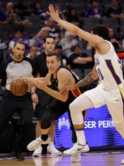 Miami Heat forward Duncan Robinson, left, drives against the Los Angeles Lakers.