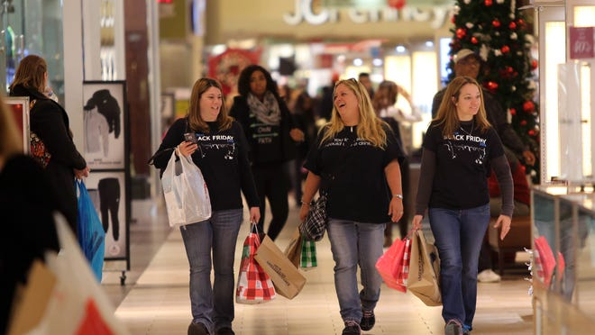 Dana Thomas (left), of Newark, Dawn Miller, of North East, Md., and Daina Smith, of Middletown, share laughs while enjoying a seventh year tradition of shopping for Black Friday deals at the Christiana Mall around 6 a.m.