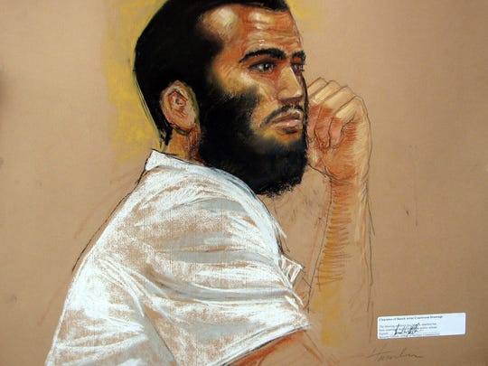 FILE - In an April 28, 2010, file artists rendering, Canadian defendant Omar Khadr attends his hearing in the courthouse for the U.S. military war crimes commission at the Camp Justice compound on Guantanamo Bay U.S. Naval Base in Cuba. An American soldier blinded in Afghanistan and the widow of another soldier killed there have filed a $44.7 million wrongful death and injury lawsuit against a Canadian man who was held at Guantanamo Bay and pleaded guilty to committing war crimes when he was 15. Layne Morris of Utah and Tabitha Speer of North Carolina filed their lawsuit Friday, May 23, 2014, in federal court in Utah against Omar Khadr, who signed a plea deal in 2010 that he committed five war crimes, including the killing of U.S. soldier Christopher Speer, in 2002. As part of the deal, Khadr admitted to throwing the grenade that killed Speer and injured other soldiers, including Morris, who lost sight in one eye from the shrapnel, the lawsuit states. The Toronto-born Khadr is serving the remainder of his eight-year sentence in Canada.