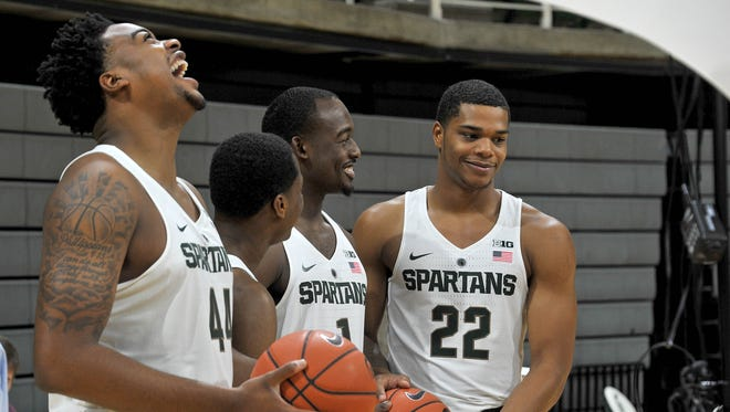 The Spartan freshman class:  Nick Ward (44), Cassius Winston (5), Joshua Langford (1) and Miles Bridges (22) share a laugh while waiting for a photographer to make up his mind about a shot.