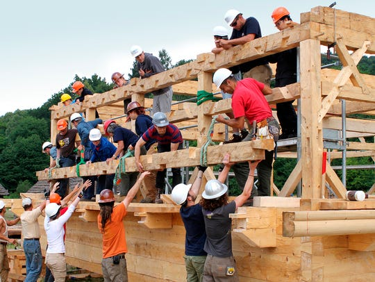 In Sanok, Poland, timber framers and students on the