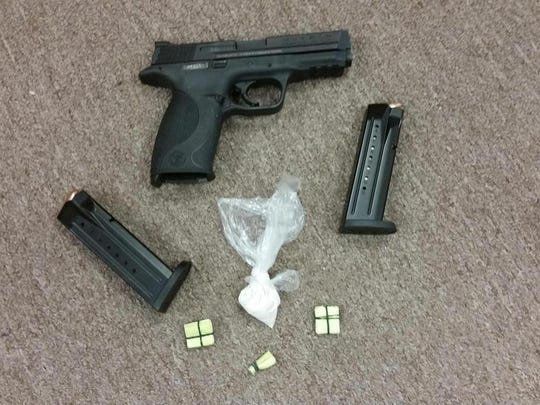 A stolen 9 mm handgun and $220 in heroin was seized from Mikhail Rodgers, 26, of York, by York City Police.