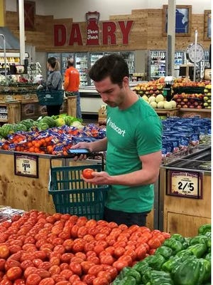 Joe Benz of Instacart selects items for delivery at a Sprouts store in Phoenix.