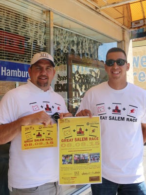 From left, David Dahle and Luis Garcia are busy promoting the Great Salem Race, an annual scavenger hunt, which is coming up Aug. 8 in downtown Salem.