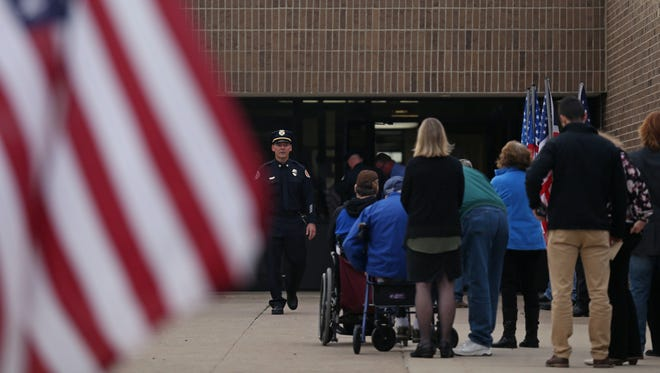 A line of people wait to enter South Central Calhoun Middle School where Urbandale police Officer Justin Martin's visitation is taking place on Monday, Nov. 7, 2016, in Rockwell City. Martin was shot and killed while on duty on Nov. 2.