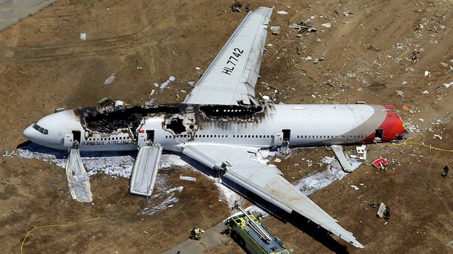 In this July 6, 2013, aerial photo, the wreckage of Asiana Flight 214 lies on the ground after it crashed at San Francisco International Airport.
