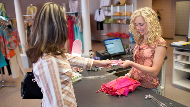 Saleswoman and customer at checkout counter