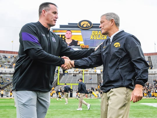 Northwestern coach Pat Fitzgerald (left, shaking Kirk Ferentz's hand) is in his 13th season leading his alma mater. Matchups with the Hawkeyes bring out the best in him, for personal reasons he is happy to share with his players.