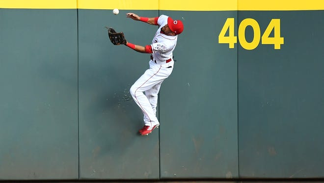 Billy Hamilton of the Cincinnati Reds makes a catch off  the center field wall in the third inning against the San Diego Padres at Great American Ball Park on Tuesday in Cincinnati, Ohio.