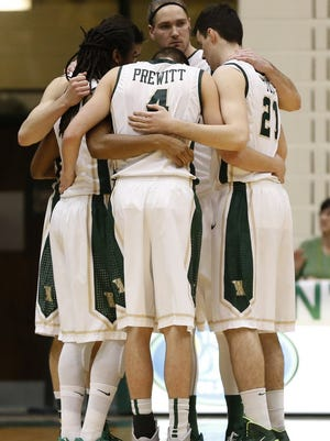 The William & Mary Tribe starting players huddle on the court prior to their game against the Elon Phoenix on Feb. 11. William and Mary is one of five schools that are original members of the NCAA and have never made it to the NCAA men's basketball tournament.